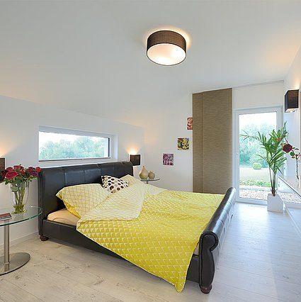 Musterhaus Schkeuditz - Ein Schlafzimmer mit einem Bett in einem Raum - Haus