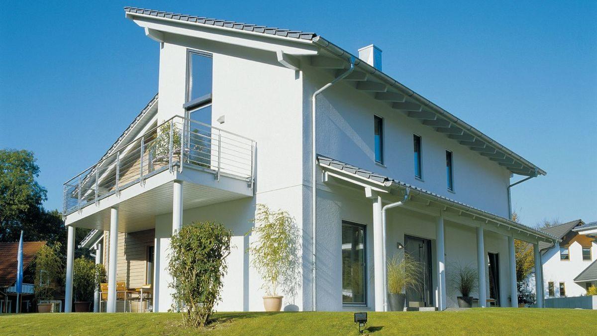Young Family Home 2 - Ein großes weißes Gebäude - Haus