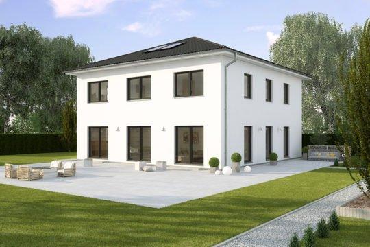 La Finca KfW-Effizienzhaus 40 - Eine große Wiese vor einem Haus - Haus