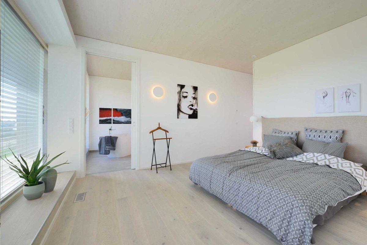 Kubos 1.2520 - Ein Schlafzimmer mit einem Bett in einem Raum - Haus