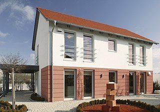Ziegelhaus Modell Poing - Ein großes Backsteingebäude - Haus