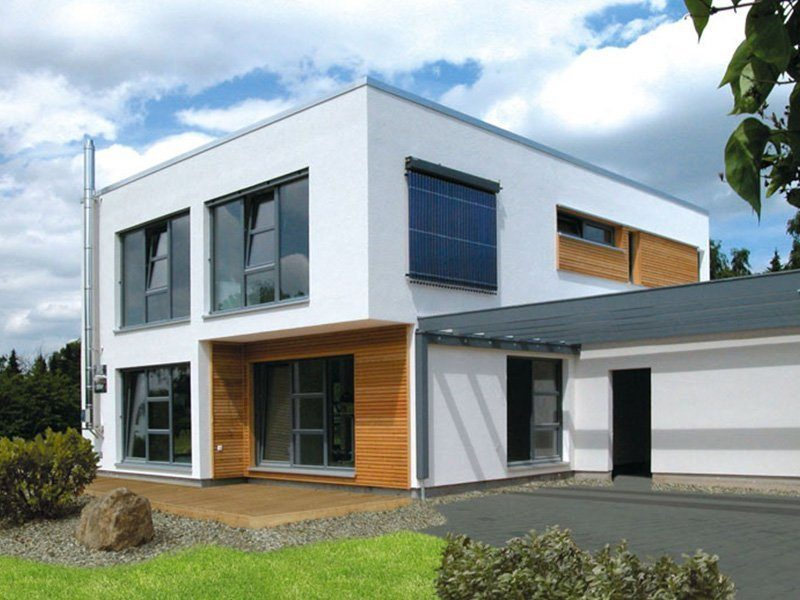 Bauhaus - Ein Haus mit Bäumen im Hintergrund - Haus