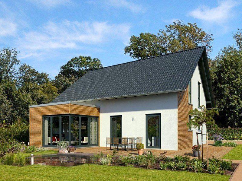 Freiraum Cube - Ein großes Backsteingebäude mit Gras vor einem Haus - Haus