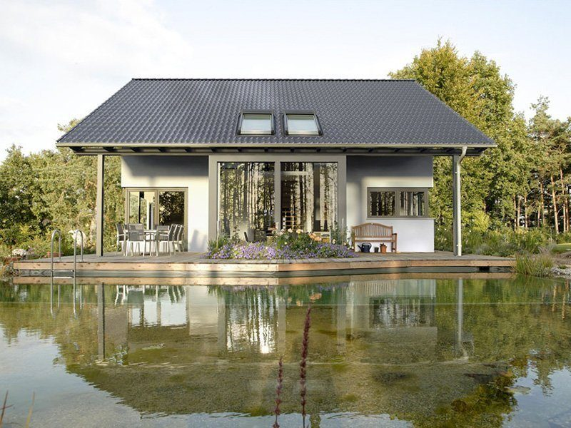 Linear - Ein kleines Haus in einem Gewässer - Haus
