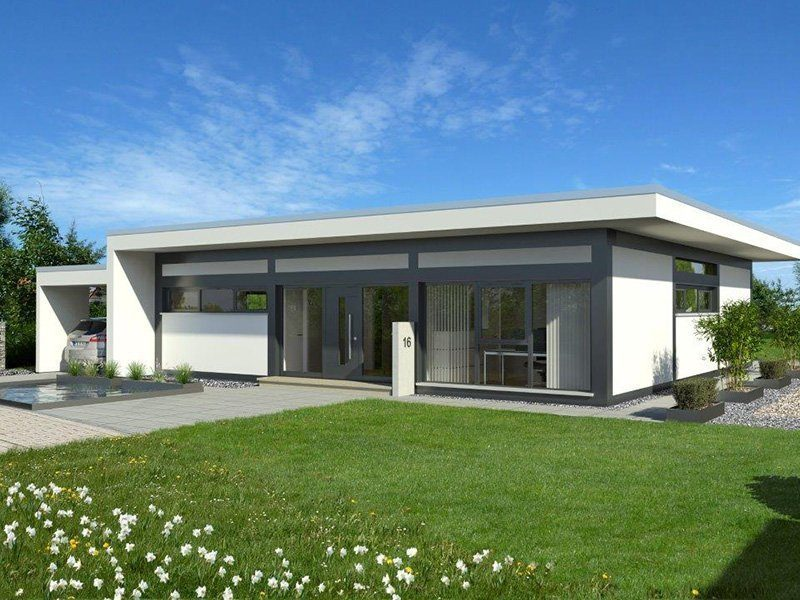 Transparentes Fachwerk auf einer Ebene - Eine große Wiese vor einem Haus - Die Architektur