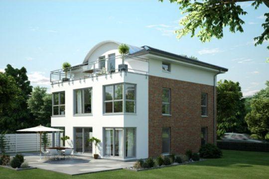 Stadtvilla FN 116-92 B V6 - Ein großes Backsteingebäude mit Gras vor einem Haus - Fertighaus