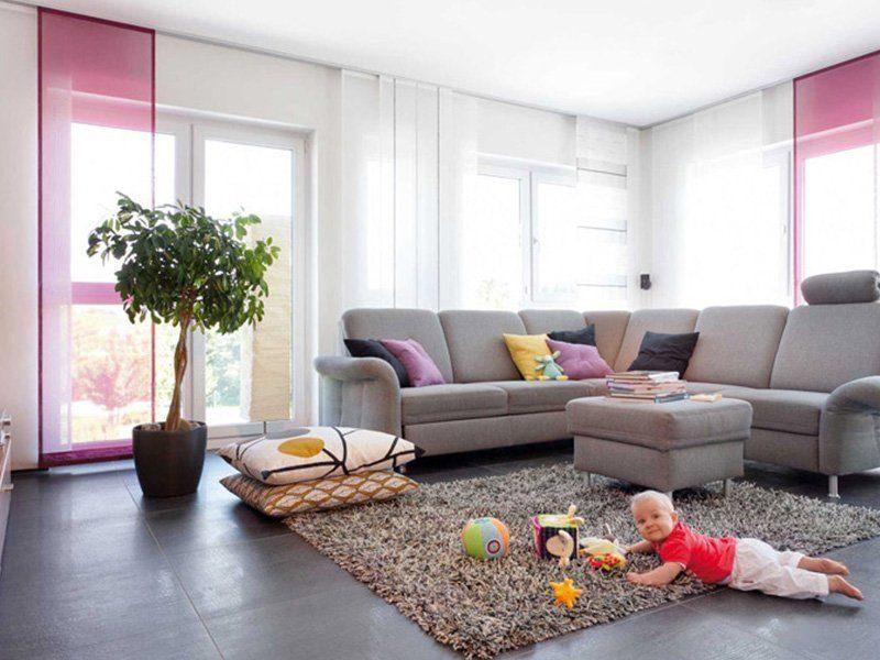 Plan E 15-171.1 - Eine Person, die in einem Wohnzimmer sitzt - Energie-Plus-Haus