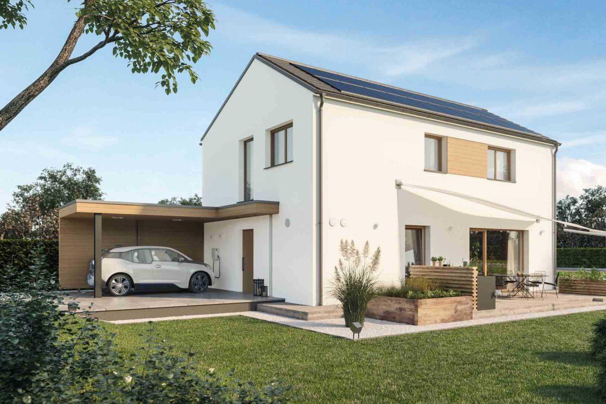 Musterhaus Sunshine - Eine große Wiese vor einem Haus - Auto