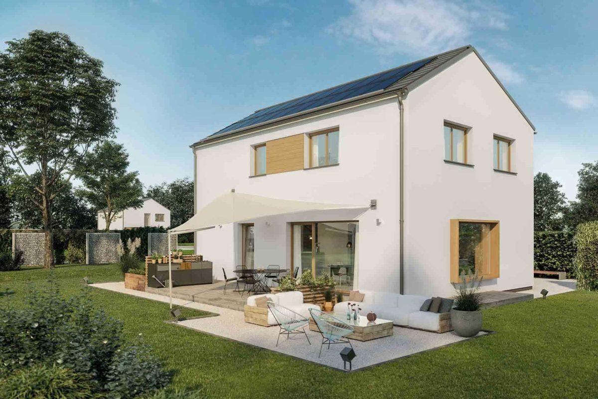 Musterhaus Sunshine - Eine große Wiese vor einem Haus - Holzhaus