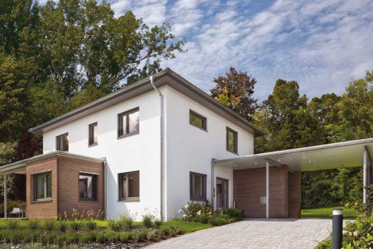 Villa 177 - Ein Haus mit Bäumen vor einem Backsteingebäude - Villa