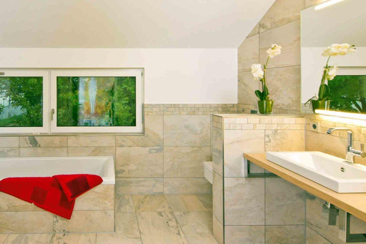 Musterhaus Future - Ein Schlafzimmer mit einem roten Waschbecken - Haus zeigen