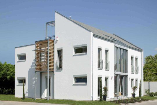 Musterhaus Mannheim - Ein großes weißes Gebäude - Haus