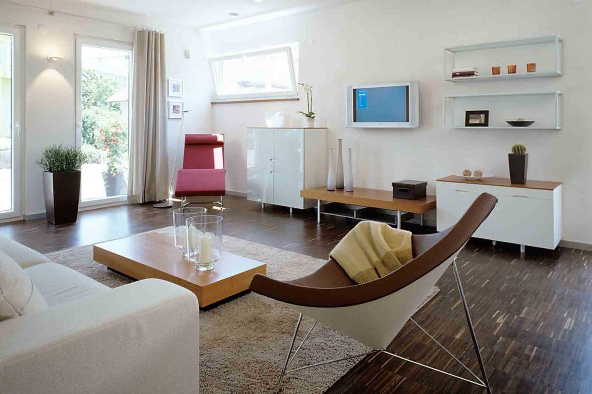 Musterhaus Mannheim - Ein Wohnzimmer mit Möbeln und einem Fernseher - LUXHAUS Musterhaus Mannheim