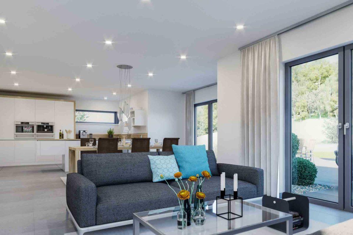 Musterhaus Mannheim - Ein Wohnzimmer mit Möbeln und einem großen Fenster - Schwabenhaus Musterhaus Ölbronn