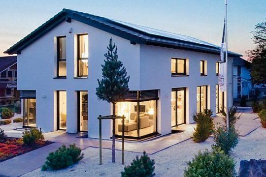 Automatisch gespeicherter Entwurf - Ein Haus mit Bäumen im Hintergrund - Bien-Zenker