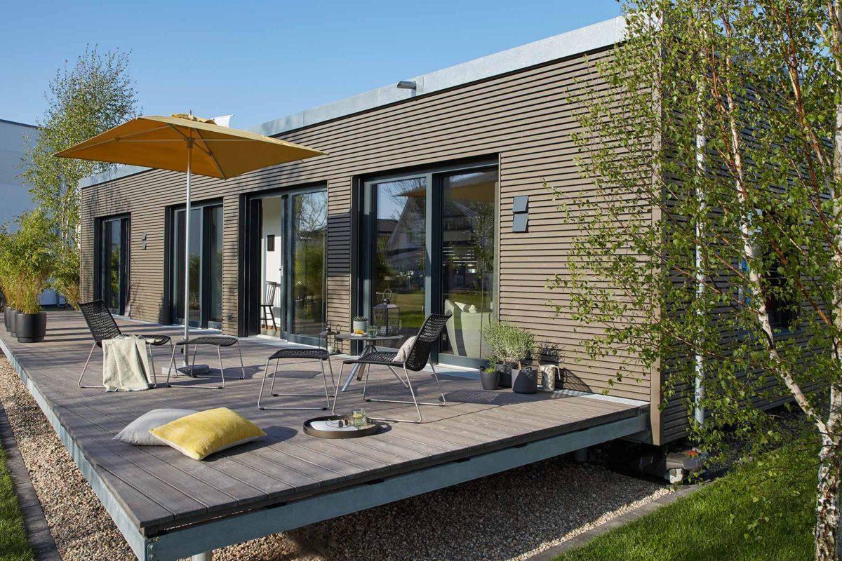 Automatisch gespeicherter Entwurf - Ein Haus mit Bäumen im Hintergrund - SchworerHaus KG