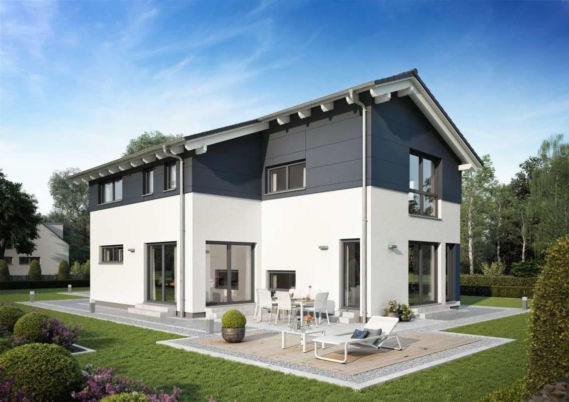 Automatisch gespeicherter Entwurf - Ein großes Backsteingebäude mit Gras vor einem Haus - FertighausWelt Köln
