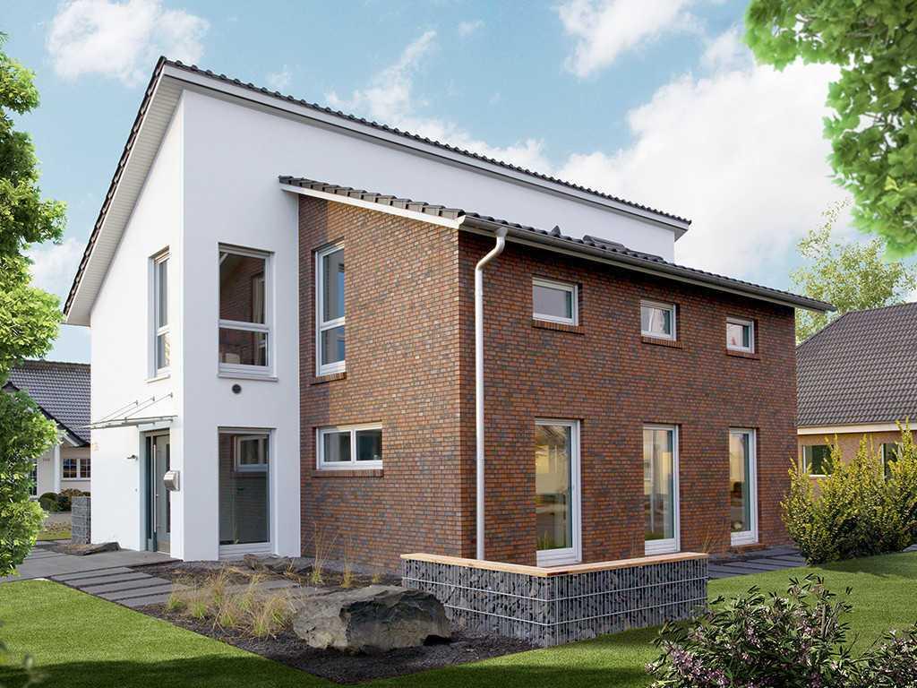 Automatisch gespeicherter Entwurf - Ein großes Backsteingebäude mit Gras vor einem Haus - Pro Haus GmbH & Co. KG i. Gr.