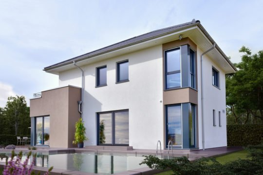 Automatisch gespeicherter Entwurf - Ein Haus mit Bäumen vor einem Gebäude - Design