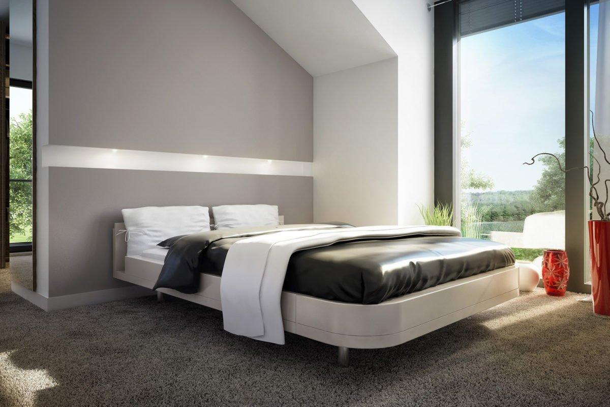 CONCEPT-M 163 München - Ein Schlafzimmer mit einem großen Bett in einem Hotelzimmer - Bien Zenker
